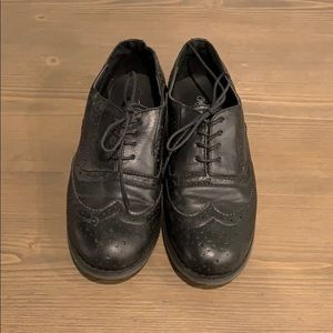 Black oxford style shoes